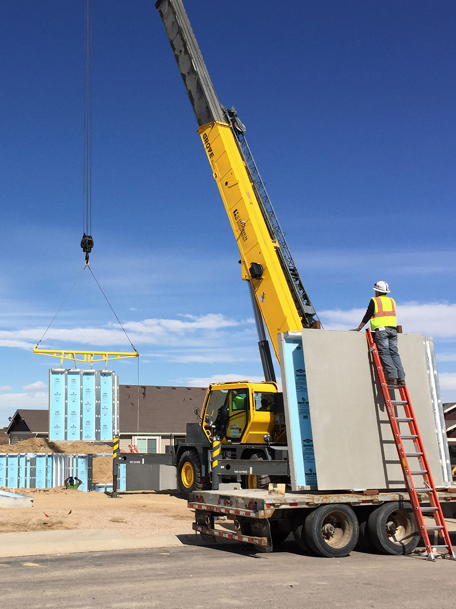 show Rocky Mountain Precast installing a Superior Walls precast concrete wall panel